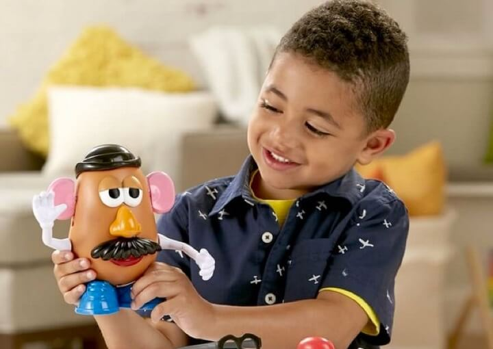Child Playing with Mr. Potato